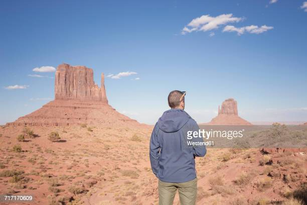 USA, Utah, back view of man looking at Monument Valley