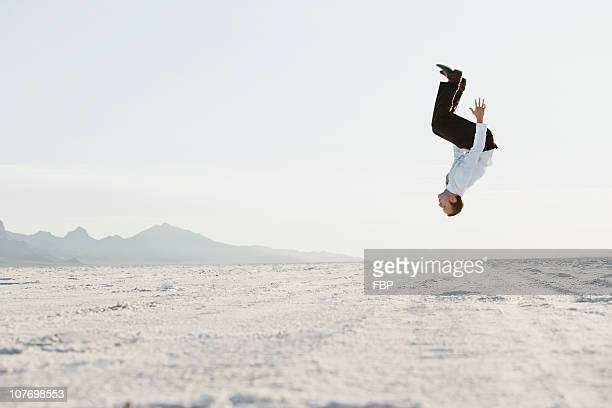 USA, Utah, Boneville Salt Flats, Young man doing backflip in desert