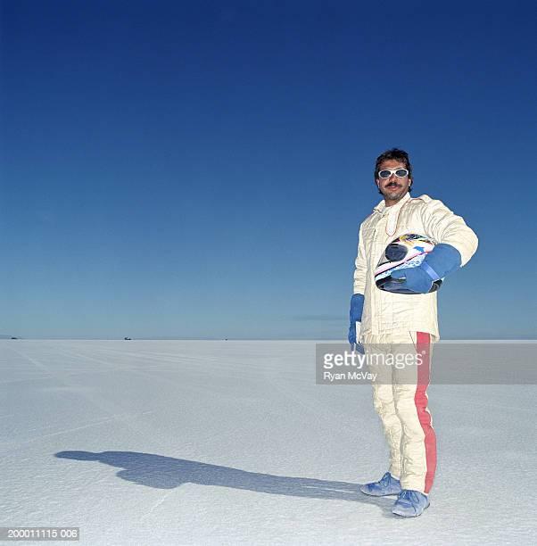 USA, Utah, Bonneville Salt Flats, racecar driver standing on raceway