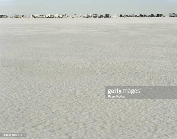 usa, utah, bonneville salt flats, row of parked trucks and trailers - bonneville salt flats stock pictures, royalty-free photos & images