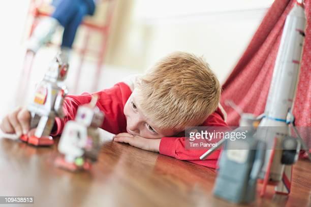 USA, Utah, Boy (6-7) playing on floor