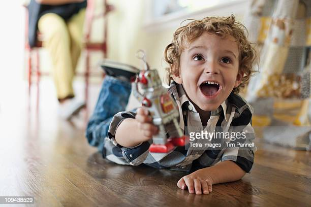 usa, utah, boy (2-3) playing on floor - toy stock pictures, royalty-free photos & images