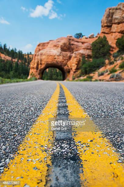 USA, Utah, Bryce Canyon, Road going under natural tunnel
