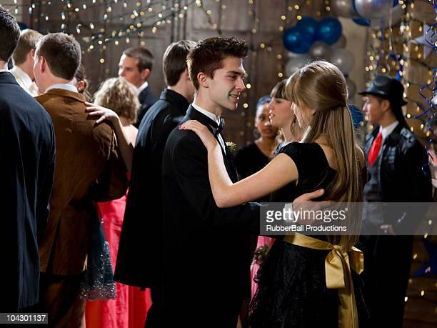 USA, Utah, Cedar Hills, Teenage couples (14-17) dancing at high school prom
