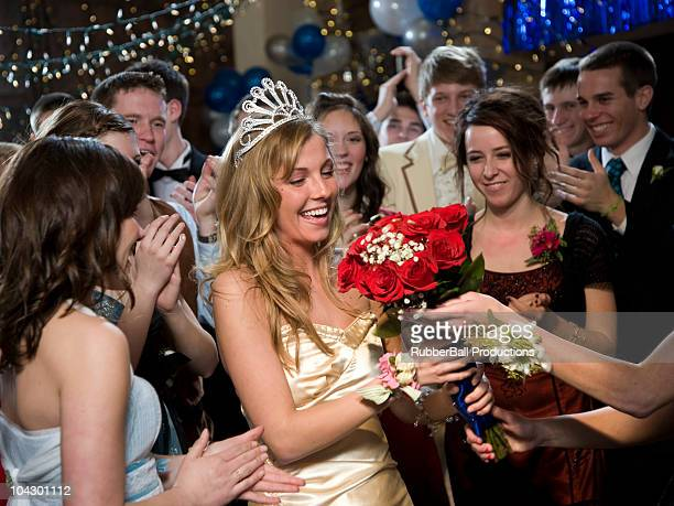 USA, Utah, Cedar Hills, Teenagers (14-17) with prom queen at high school prom
