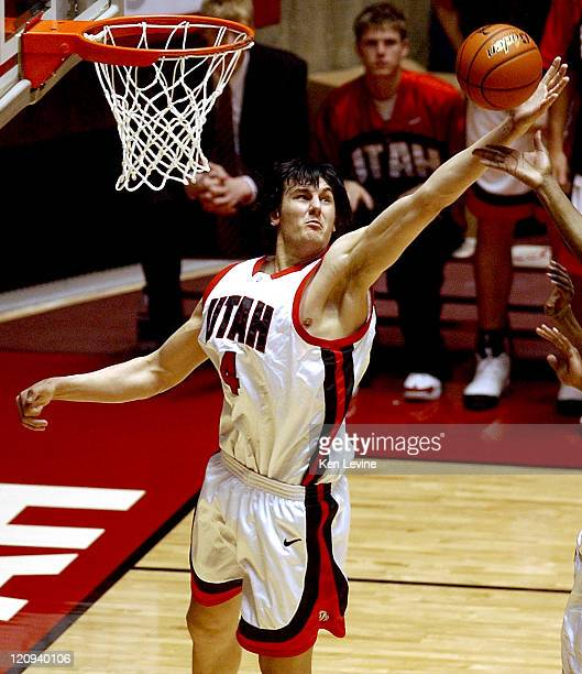 Utah center Andrew Bogut leaps and snags a rebound Utah defeated San Diego State 7260 at the Jon Huntsman Center in Salt Lake City Utah on March 5...