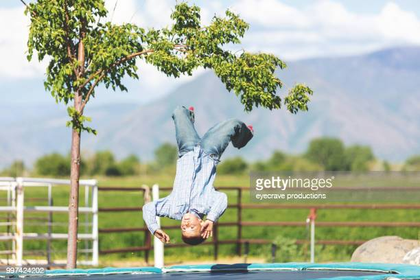 Utah Children Playing Jumping on Trampoline Cowboy Cowgirls Western Outdoors and Rodeo Stampede Roundup Riding Horses Herding Livestock iStock Photoshoot