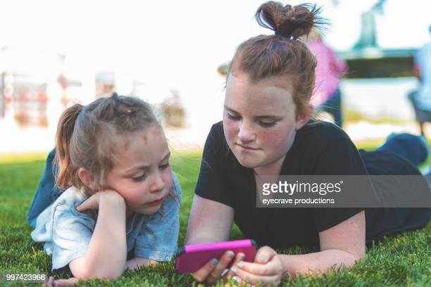 Utah Children Playing with Smart Phone watching Video Cowboy Cowgirls Western Outdoors and Rodeo Stampede Roundup Riding Horses Herding Livestock iStock Photoshoot