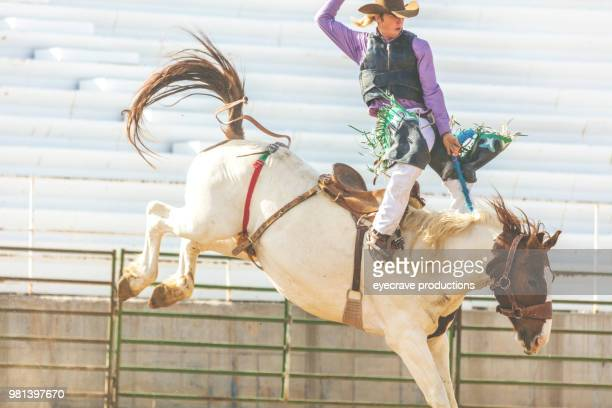 Utah Cowboy Saddle Bronc Arena Bareback Riding Western Outdoors and Rodeo Stampede Roundup Riding Horses Herding Livestock