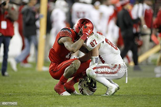 Utah DB Brian Allen consoles a disappointed Indiana WR Mitchell Paige after the Foster Farms Bowl between the Indiana Hoosiers and Utah Utes on...