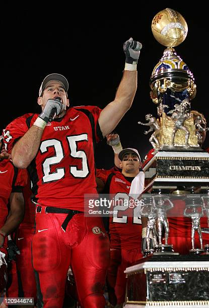 Utah defensive back Morgan Scalley celebrates by the trophy The Utes won the Fiesta Bowl 35 7 against the Pittsburgh Panthers in Phoenix AZ on...