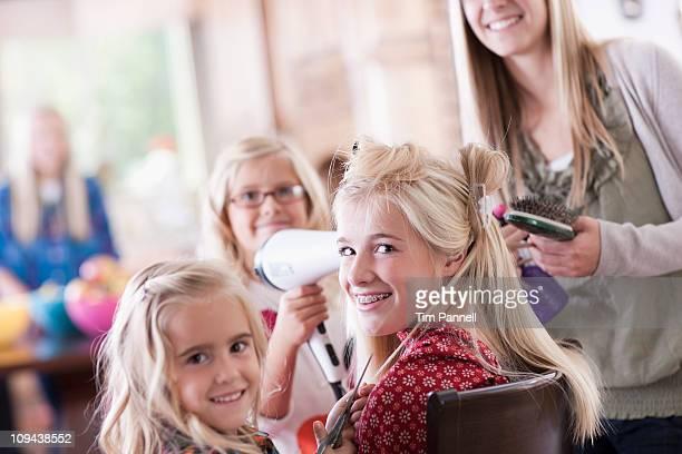 USA, Utah, family portrait  of sisters  (6-7, 8-9, 12-13, 14-15, 16-17) preparing hairs and having fun