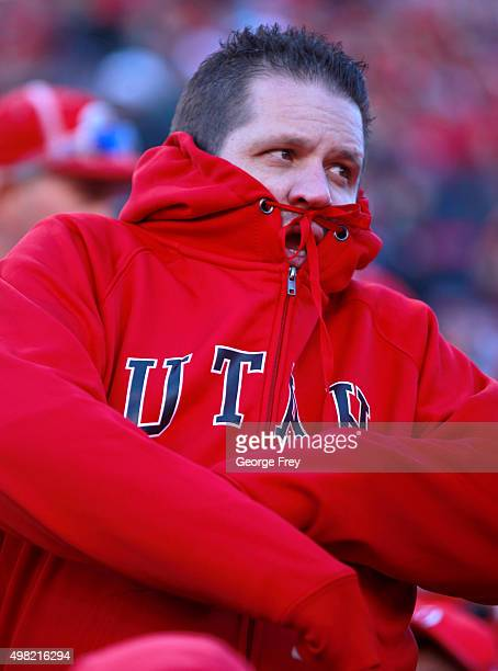 Utah fan tries to stay warm late in the game against the UCLA Bruins and the Utah Utes during the second half of a college football game at Rice...
