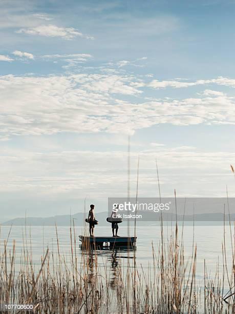 usa, utah, garden city, boys (10-11,12-13) jumping from raft - 10 11 jahre stock-fotos und bilder