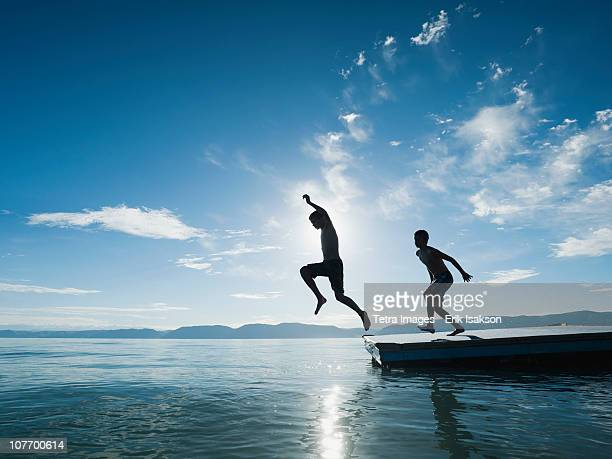 USA, Utah, Garden City, Boys (10-11,12-13) jumping from raft