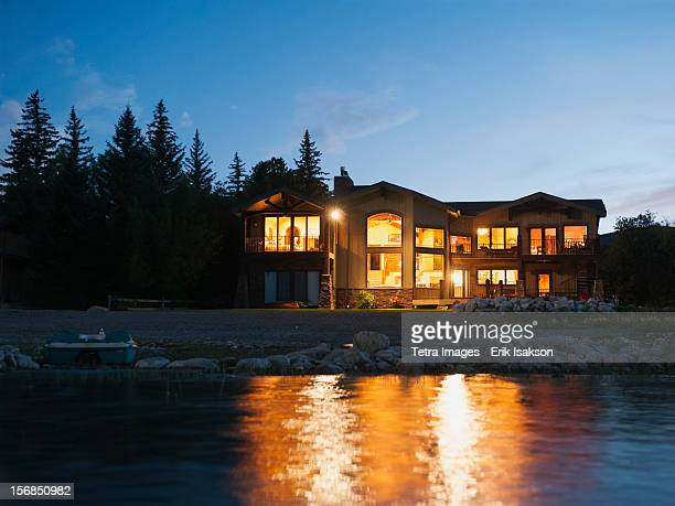 USA, Utah, Garden City, evening view of holiday villa from lake