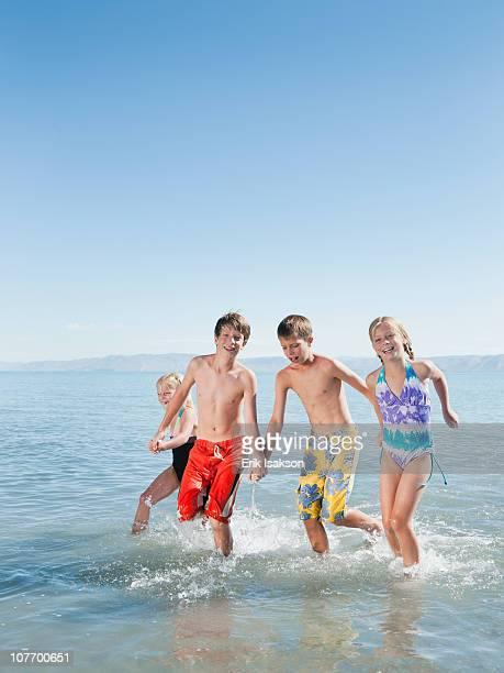 USA, Utah, Garden City, Kids (6-7,8-9,10-11,12-13) playing in lake