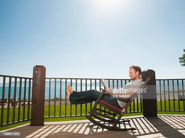 USA, Utah, Garden City, mid-adult man relaxing on rocking chair