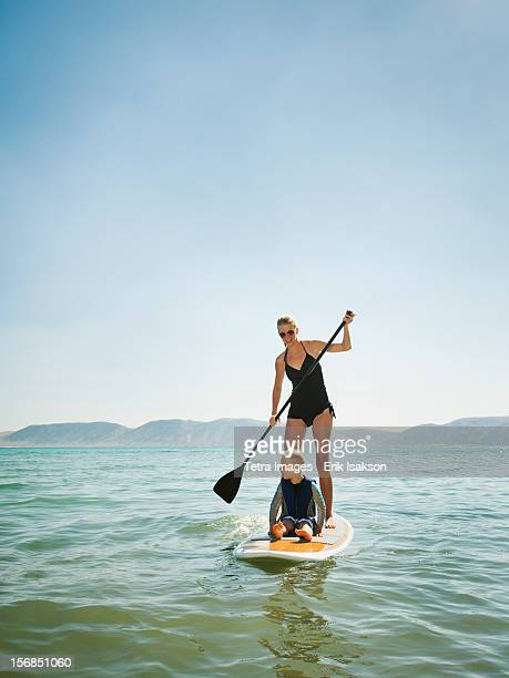 USA, Utah, Garden City, young woman with daughter (4-5) on paddleboard