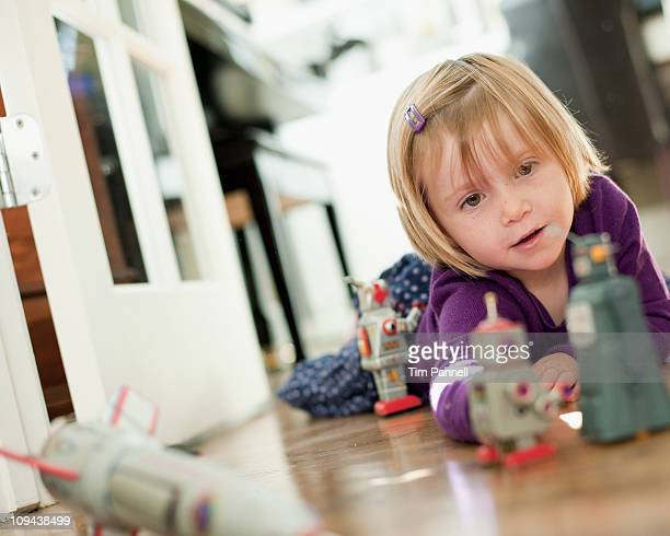 USA, Utah, Girl (2-3) playing on floor