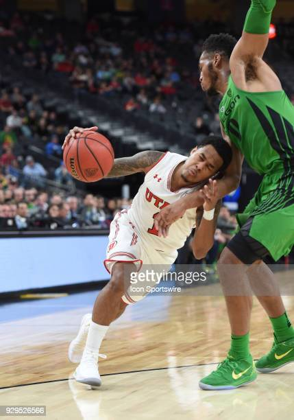 Utah guard Justin Bibbins smashes his head into the gut of Oregon forward Troy Brown during the PAC12 Men's Basketball Tournament game between the...