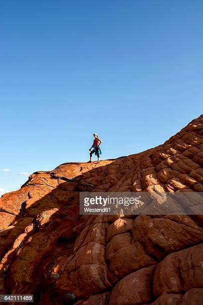 USA, Utah, Hiker in Snow Canyon State Park