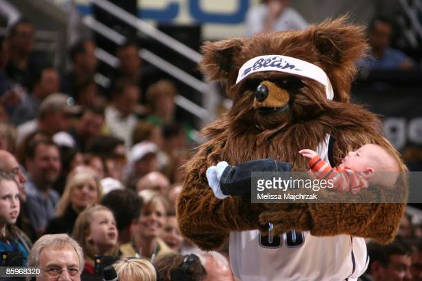 Utah Jazz Bear takes baby around court during a timeout between the Utah Jazz and the Los Angeles Clippers at EnergySolutions Arena on April 13 2009...