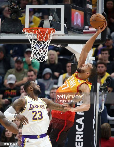TOPSHOT Utah Jazz center Rudy Gobert dunks the ball over Los Angeles Lakers forward LeBron James during an NBA game in Salt Lake City Utah on...