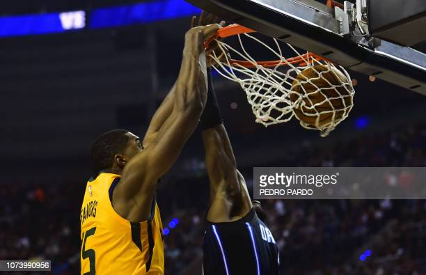 Utah Jazz´ Derrick Favors scores a basket during their NBA Global Games match against the Orlando Magic at the Mexico City Arena on December 15 in...