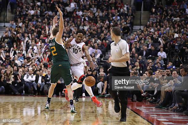 TORONTO ON JANUARY 5 Utah Jazz forward Joe Ingles fouls Toronto Raptors guard DeMar DeRozan as the Toronto Raptors beat the Utah Jazz 10193 at Air...