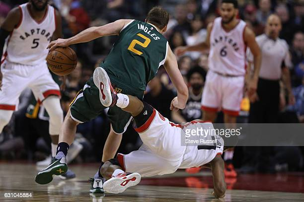 Utah Jazz forward Joe Ingles fouls Toronto Raptors guard Kyle Lowry as the Toronto Raptors beat the Utah Jazz 101-93 at Air Canada Centre in Toronto....