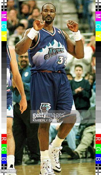 Utah Jazz forward Karl Malone acknowledges the fans at Gund Arena in Cleveland Ohio after Malone became the 11th player in NBA history to reach 20000...