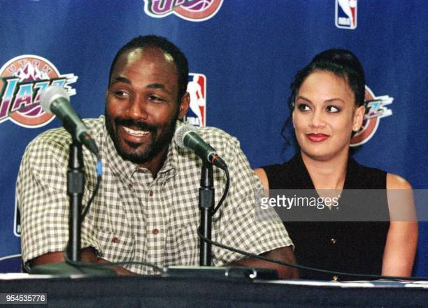 Utah Jazz forward Karl Malone speaks at a press conference announcing his new four year 67 million USD contract beside his wife Kay 01 August 1999 in...