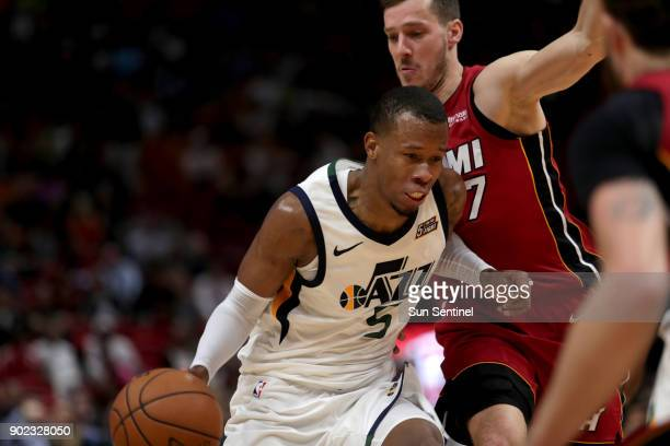 Utah Jazz forward Rodney Hood tries to muscle his way past Miami Heat guard Goran Dragic on Sunday Jan 7 2018 at the AmericanAirlines Arena in Miami...