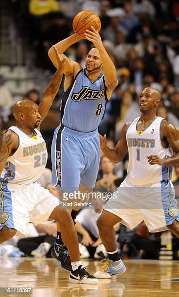 Utah Jazz guard Deron Williams shoots in the third quarter while Denver Nuggets guard Anthony Carter and Denver Nuggets guard Chauncey Billups try to...