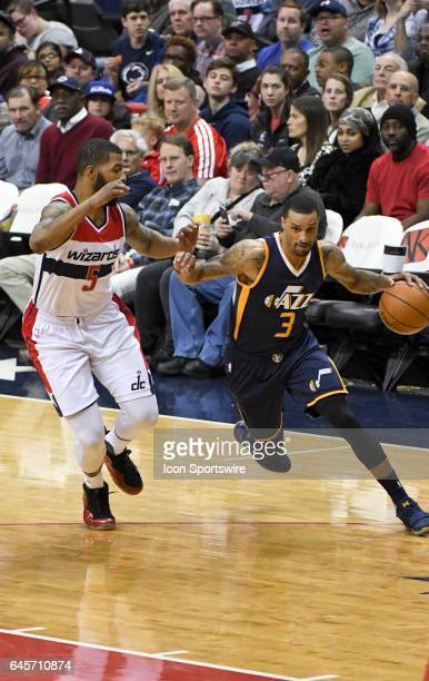 Utah Jazz guard George Hill drives to the basket and is fouled by Washington Wizards forward Markieff Morris on February 26 at the Verizon Center in...