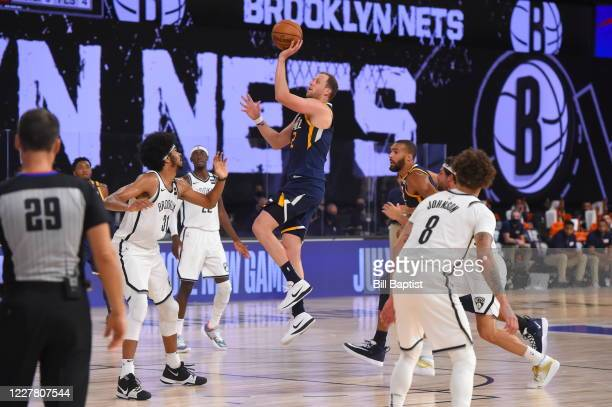Utah Jazz guard Joe Ingles handles the ball against the Brooklyn Nets during a scrimmage on July 27, 2020 at HP Field House at ESPN Wide World of...