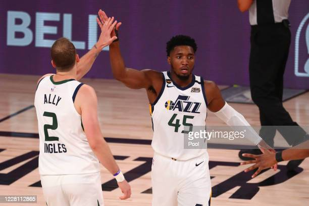 Utah Jazz guard Joe Ingles of the Utah Jazz and Donovan Mitchell celebrate against the Denver Nuggets during game two in the first round of the 2020...