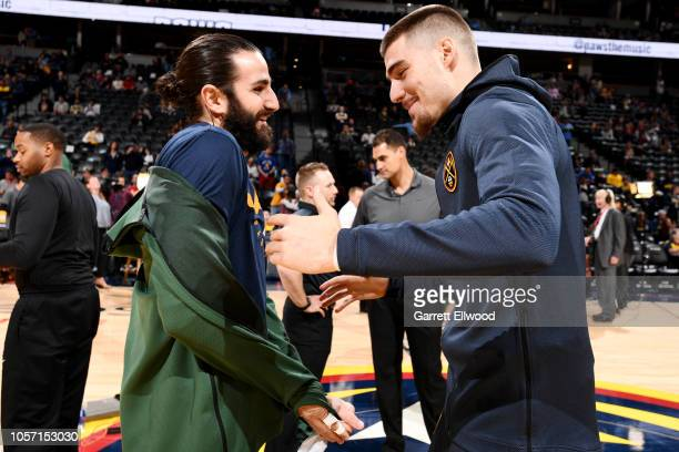 Utah Jazz guard Ricky Rubio and Denver Nuggets forward Juan Hernangomez share a laugh prior to the game between the Utah Jazz and the Denver Nuggets...