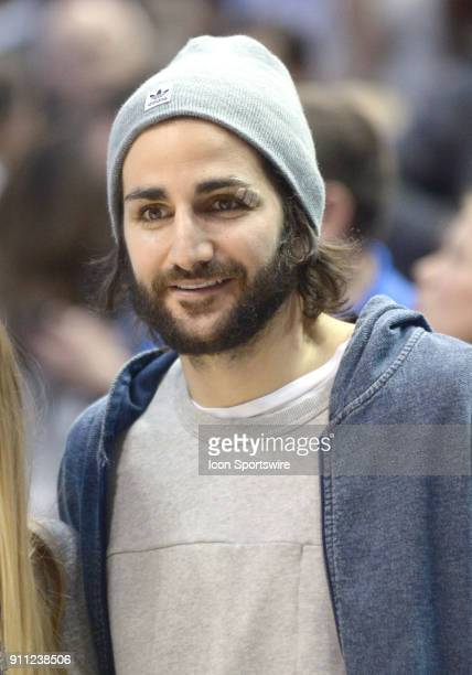 Utah Jazz guard Ricky Rubio poses with a fan after a game between Pacific and BYU on January 27 2018 at the Marriott Center in Provo Utah