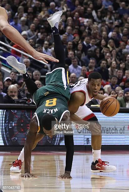 TORONTO ON JANUARY 5 Utah Jazz guard Shelvin Mack fouls Toronto Raptors guard Kyle Lowry flying right over him as the Toronto Raptors beat the Utah...