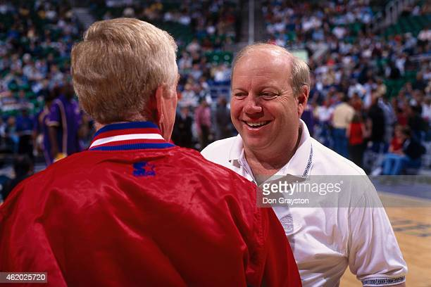 Utah Jazz owner Larry Miller talks to a referee during a game circa 1999 at the Delta Center in Salt Lake City Utah NOTE TO USER User expressly...