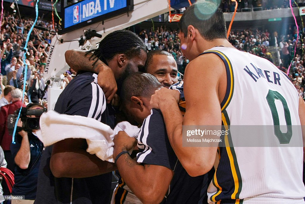 Utah Jazz players, from left, DeMarre Carroll #3, Earl Watson #11, Mo Williams #5, and Enes Kanter #0 celebrate their team's last second victory against the San Antonio Spurs at Energy Solutions Arena on December 12, 2012 in Salt Lake City, Utah.