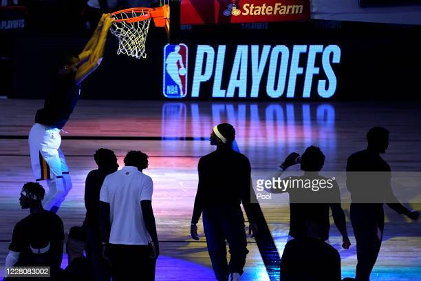 Utah Jazz players gather near the hoop prior to an NBA basketball first round playoff game against the Denver Nuggets at The Field House at ESPN Wide...