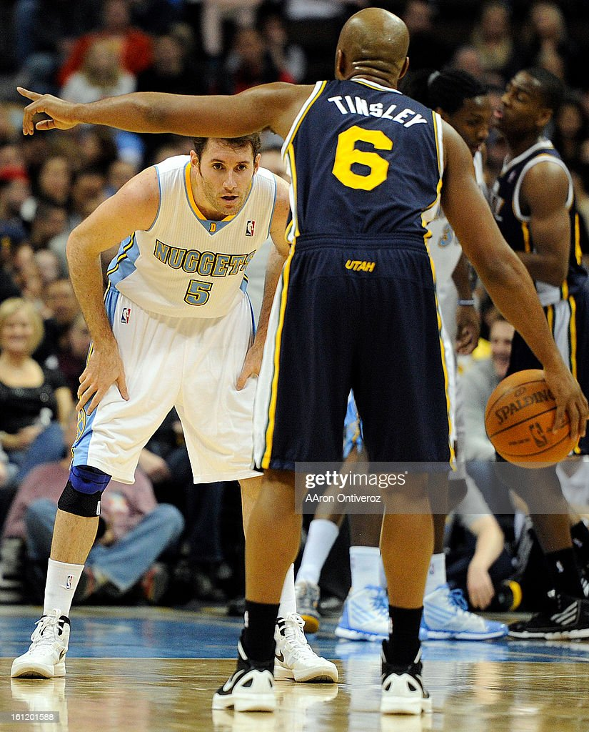 Utah Jazz point guard Jamaal Tinsley (6) calls a play as Denver Nuggets shooting guard Rudy Fernandez (5) defends during the fourth quarter of the Nuggets' 117-100 at the Pepsi Center on Wednesday, December 28, 2011. AAron Ontiveroz, The Denver Post : News Photo