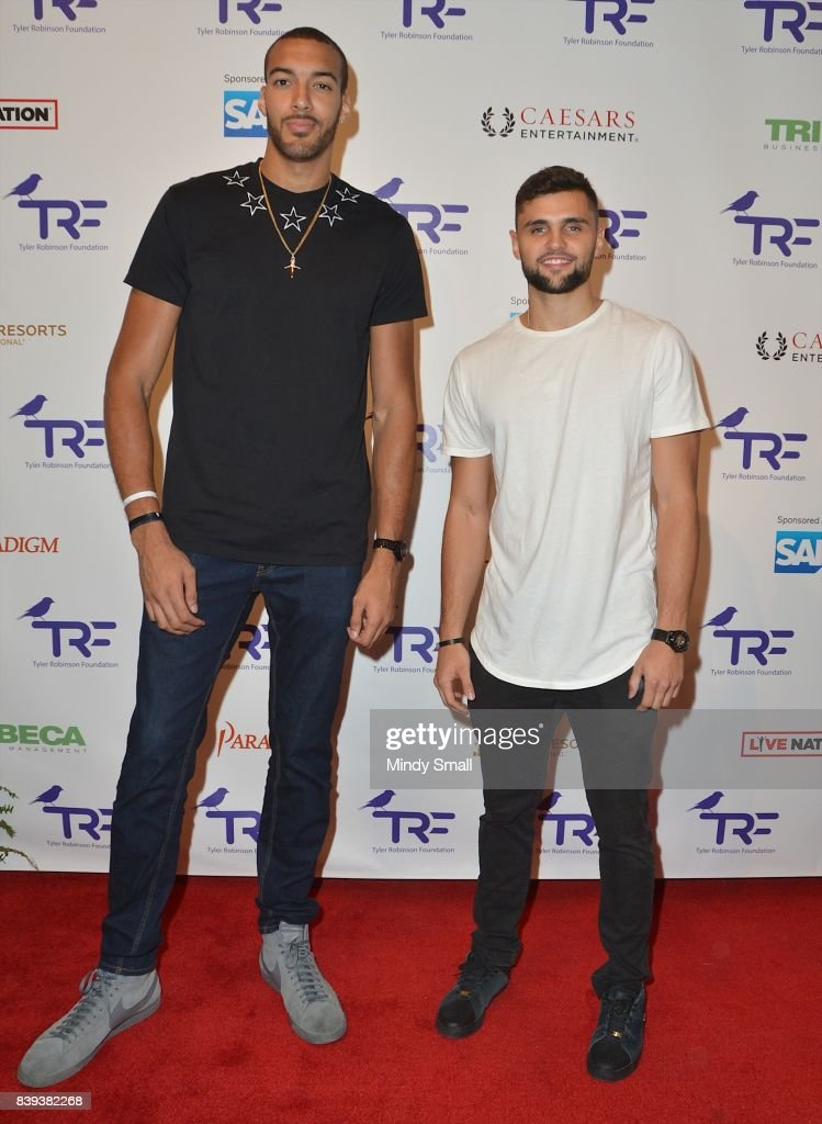 Utah Jazz professional basketball players Rudy Gobert (L) and Raul Neto attend the fourth annual Tyler Robinson Foundation gala benefiting families affected by pediatric cancer at Caesars Palace on August 25, 2017 in Las Vegas, Nevada.