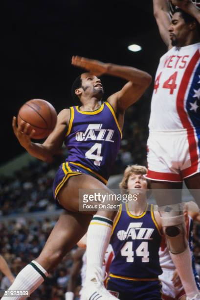 Utah Jazz's Adrian Dantley drives the ball against the Adrian Dantley of the New York Nets during a game at the Meadowlands Arena circa 1980 in East...