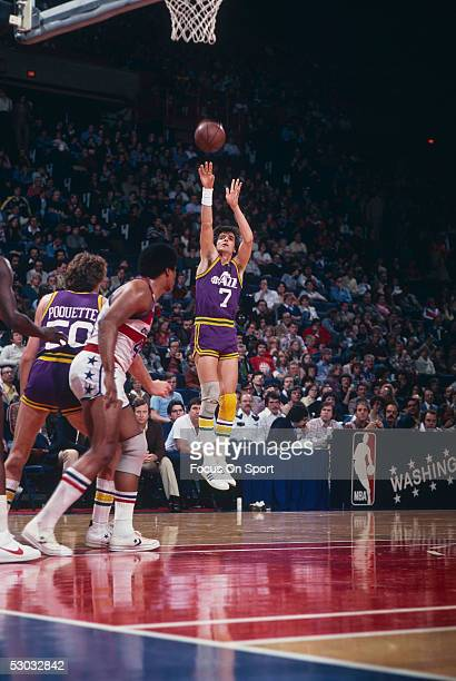 Utah Jazz's guard Pete Maravich jumps and shoots near the basket during a game against the Washington Bullets at Capital Center circa 1979 in...