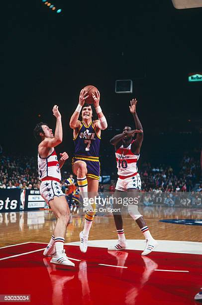 Utah Jazz's guard Pete Maravich jumps and shoots near the basket during a game against the Washington Bullets at Capital Center circa 1977 in...