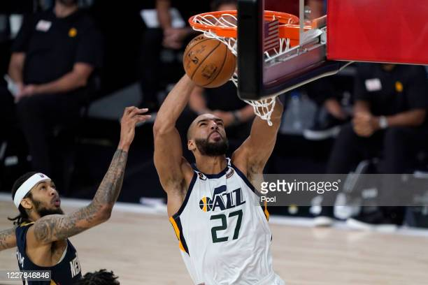 Utah Jazz's Rudy Gobert heads to the basket past New Orleans Pelicans' Brandon Ingram, left, during the second half of an NBA basketball game on July...